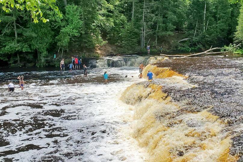 Best Michigan waterfall swimming. Best Upper Peninsula waterfall swimming. up michigan travel blog