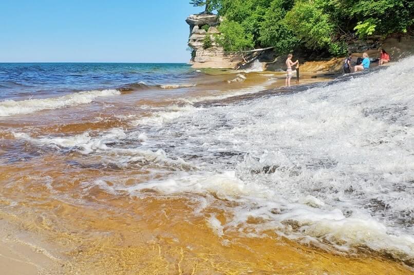 Best Michigan waterfalls: Chapel Beach Falls. waterfalls into lake superior. Best UP waterfalls upper peninsula. up michigan travel blog