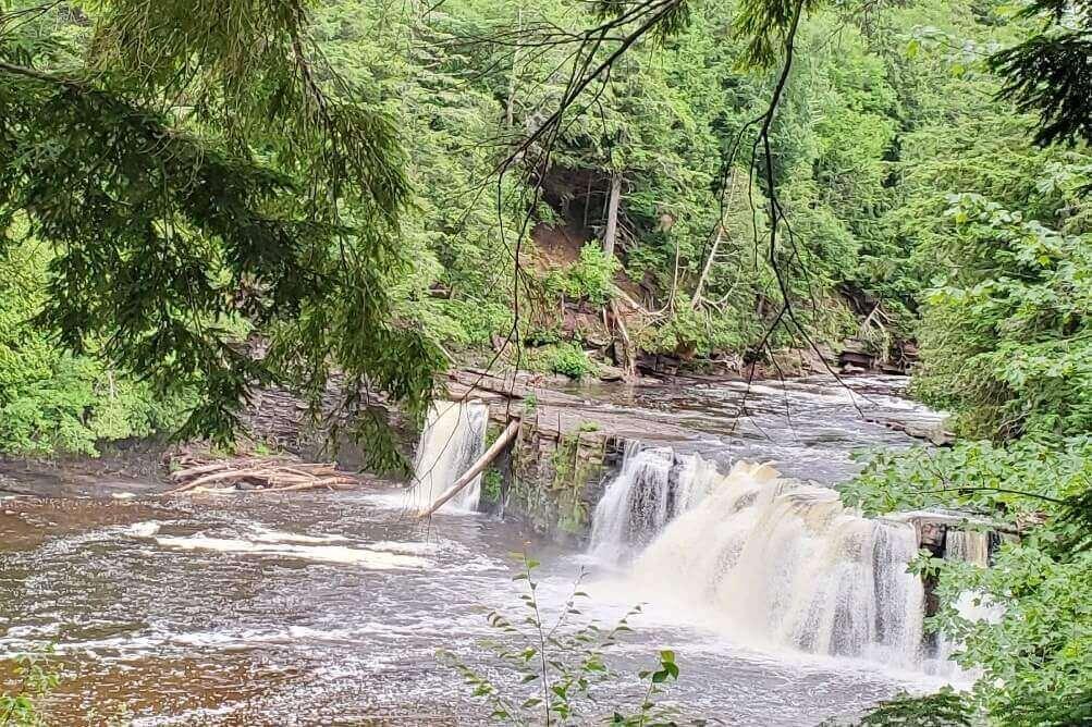 Best Michigan waterfalls: Manabezho Falls, Preque Isle River, Porcupine Mountains. Best UP waterfalls upper peninsula. up michigan travel blog