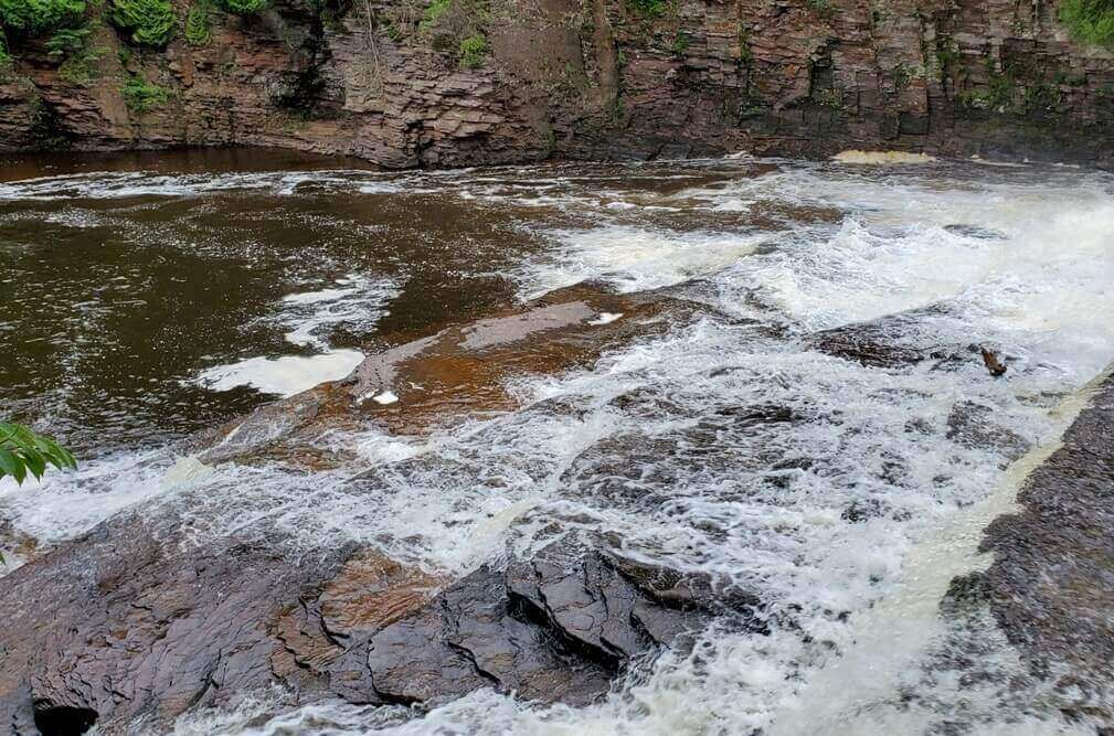 Best Michigan waterfalls: Nawadaha Falls, Preque Isle River, Porcupine Mountains. Best UP waterfalls upper peninsula. up michigan travel blog