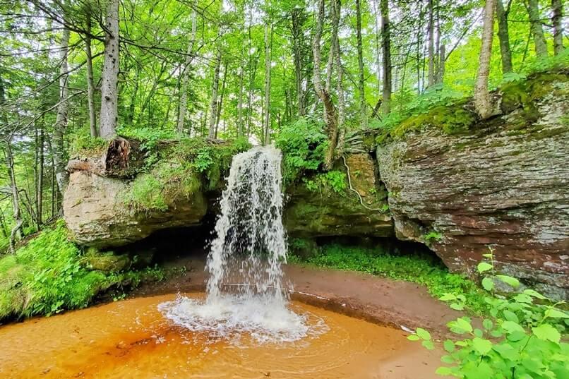 Michigan roadside waterfalls: Scott Falls. walk behind waterfalls. Best UP waterfalls upper peninsula. up michigan travel blog