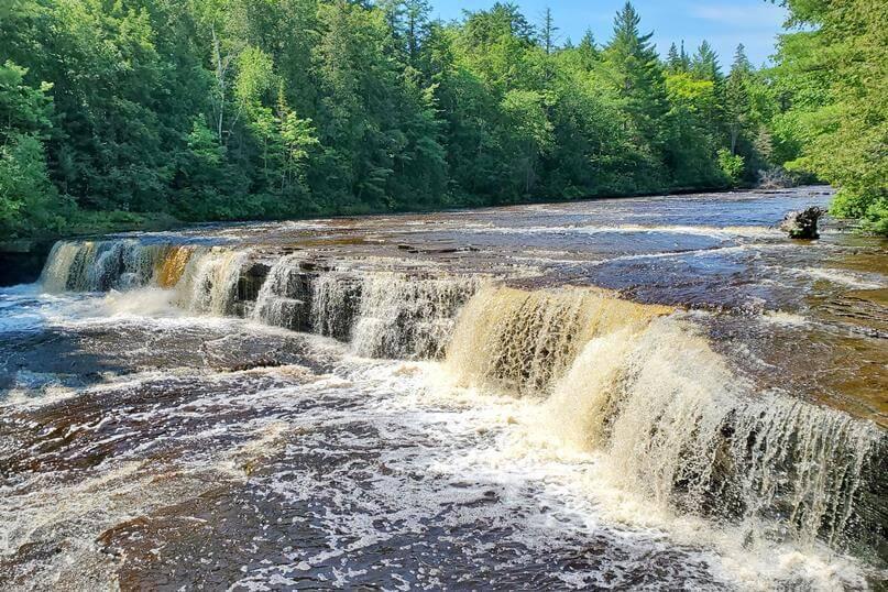 Best Michigan waterfalls: Tahquamenon Falls, Lower Falls. Best UP waterfalls upper peninsula. up michigan travel blog