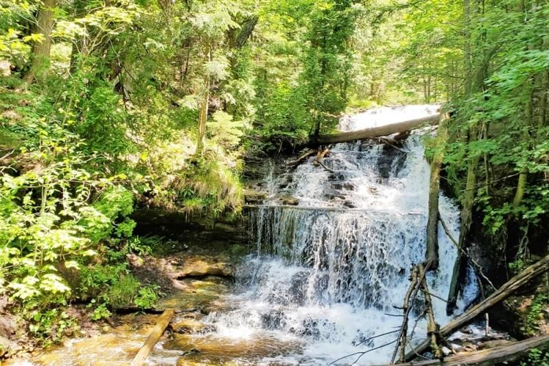 Best Michigan waterfalls: Wagner Falls. Best UP waterfalls upper peninsula. up michigan travel blog